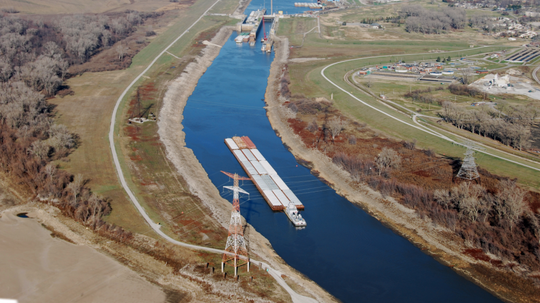 A barge filled with ag commodities makes its way down the Missouri River.