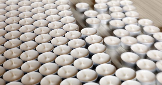 Candles whisk along a conveyer belt at United Candle's Norwich facility.