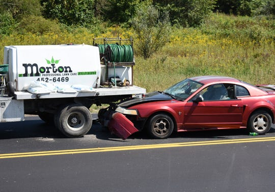 The driver and a passenger of the red Ford Mustang were taken to the hospital with minor injuries after the car ran into a Morton Lawn Care truck on Newark Road on Monday.