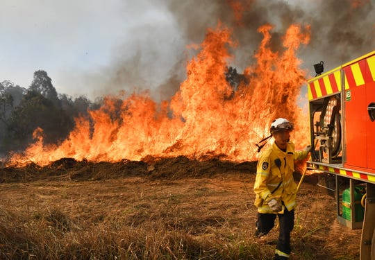 New South Wales Rural Fire Service firefighters back burning and fighting fires on Long Gully Road in the northern New South Wales town of Drake, Australia on September 9, 2019. A number of homes have been destroyed by bushfires in northern New South Wales and Queensland.