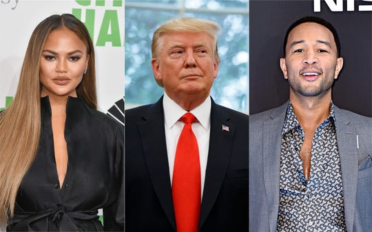 President Donald Trump sandwiched between Chrissy Teigen and John Legend