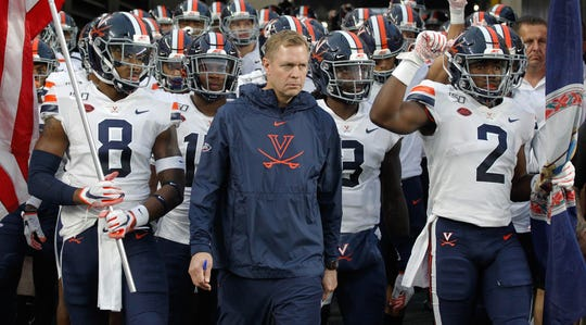 Virginia coach Bronco Mendenhall prepares to lead his team on to the field for their season opener against Pittsburgh.