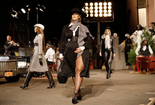 Ashley Graham walks down the runway as she exhibits a creation by designer Tommy Hilfiger during New York Fashion Week.