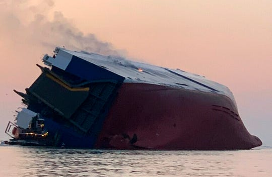 Coast Guard crews and port partners respond to an overturned cargo vessel with a fire on board on Sept. 8, 2019, in St. Simons Sound, Ga.