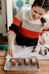 "Molly Yeh puts the finishing touches on mini marzipan candy bars in ""Girl Meets Farm."""