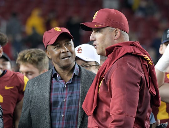 Southern California athletic director Lynn Swann (left) talks with football coach Clay Helton after the 2017 Pac-12 Conference championship game.