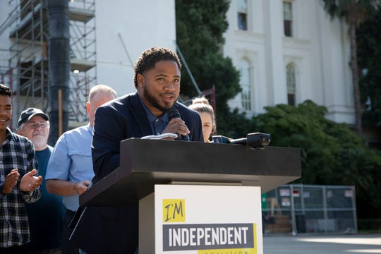 Jermaine Brown, a Lyft driver, asked  lawmakers in Sacramento, Calif., to desire his reputation as an honest contractor on Monday, Sept. 9, 2019.