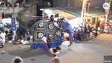 Two elephants escaped handlers at a parade in Sri Lanka and went on a rampage through the streets.