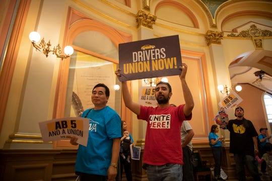 Concerned citizens rally in pork up of AB 5, laws that would reclassify honest contractors as staff, in Sacramento, Calif., on Monday, Sept. 9, 2019.