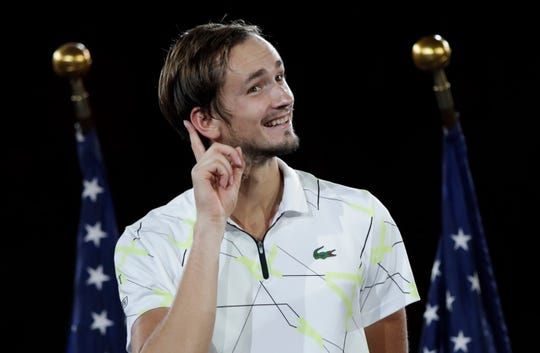 U.S. Open runner-up Daniil Medvedev put his finger to his ear to hear fans' cheers.
