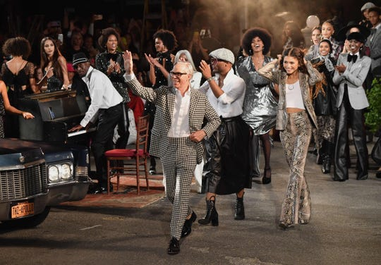 Designer Tommy Hilfiger and actress Zendaya walk the runway at the Tommy Hilfiger TommyNow fall runway show at the Apollo Theater on September 8, 2019 in New York City. (Photo by Angela Weiss / AFP)ANGELA WEISS/AFP/Getty Images ORG XMIT: NYFW Wome ORIG FILE ID: AFP_1K492X