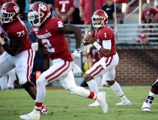 Oklahoma quarterback Jalen Hurts looks to throw during the first half against South Dakota.
