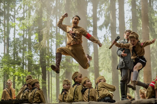 "Adolf (Taika Waititi, left) and Jojo (Roman Griffin Davis) crash the hand-grenade event at a Nazi youth training weekend in ""Jojo Rabbit."""
