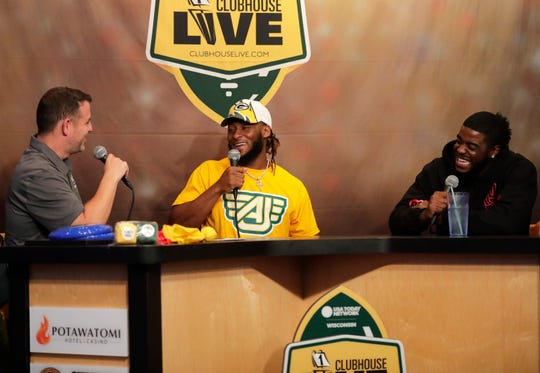 Green Bay Packers running back Aaron Jones (center) talks with Clubhouse Live host Brett Christopherson (left) on Monday in Appleton. Packers rookie running back Dexter Williams (right) was Jones' guest.