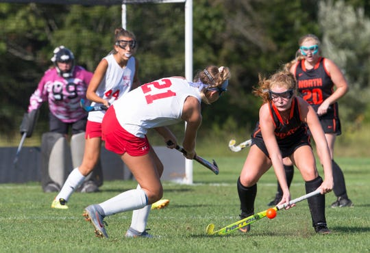 Wall Claire Ferguson tries to get ball past Middletown North's Gianna Antenucci during first half action. Wall Field Hockey vs Middletown North in Wall, NJ on September 10, 2019.