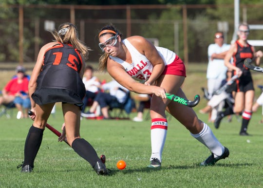 Wall Megan Surgent hits ball past Middletown North Shannon Denehy. Wall Field Hockey vs Middletown North in Wall, NJ on September 10, 2019.
