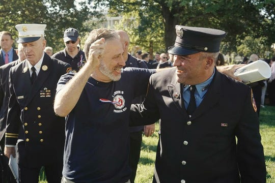 Joe McKay, shown with Jon Stewart, is a former New York City firefighter who developed a disabling illness after serving on the cleanup crew at ground zero