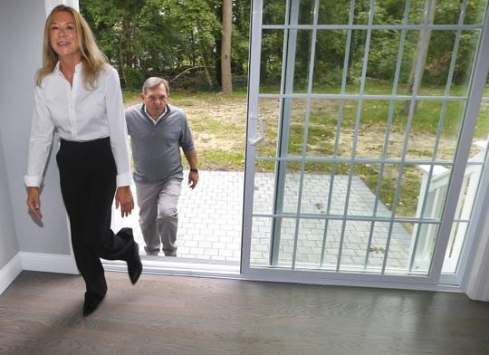 DeLynn and Gary Schecher, owners of Cross Builders LLC, walk into a home they have built in Long Branch.  Tuesday, September 10, 2019.