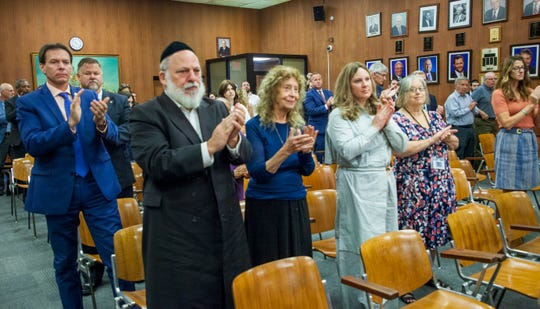 People give a standing ovation to US special envoy to monitor and combat anti-Semitism, Elan Carr, after his presentation at the Lakewood Township. Municipal Building on Sept. 9, 2019.