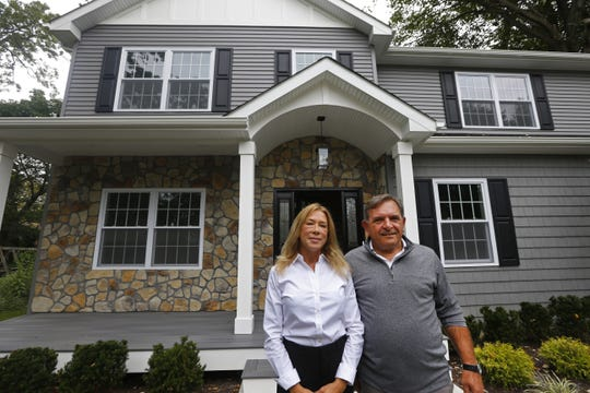 DeLynn and Gary Schecher, owners of Cross Builders LLC, stand beforea Long Branch home they built. Tuesday, September 10, 2019.