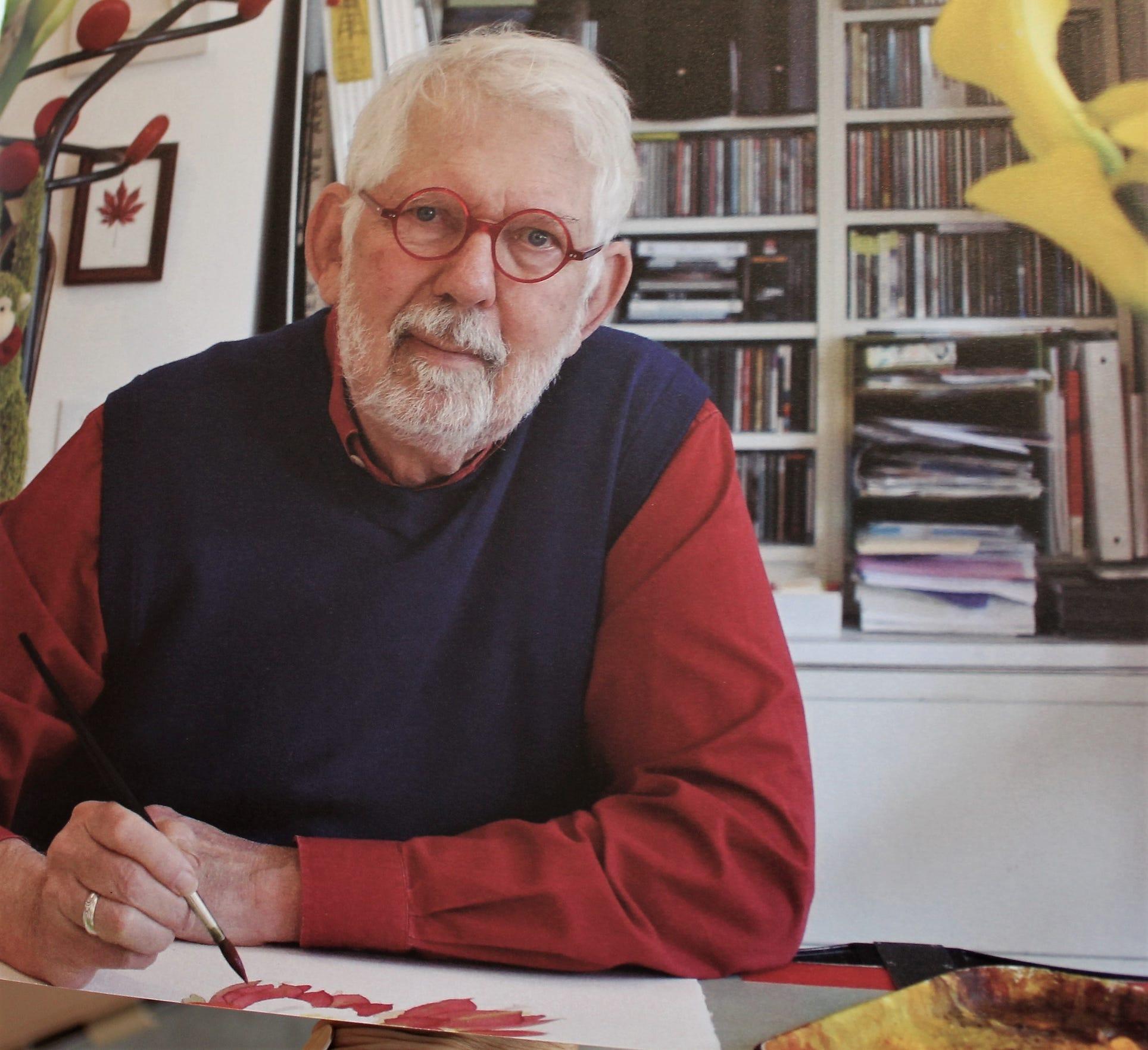 "Artist Gary Bukovnik, pictured in his book ""Flowers - Forever Spring."""