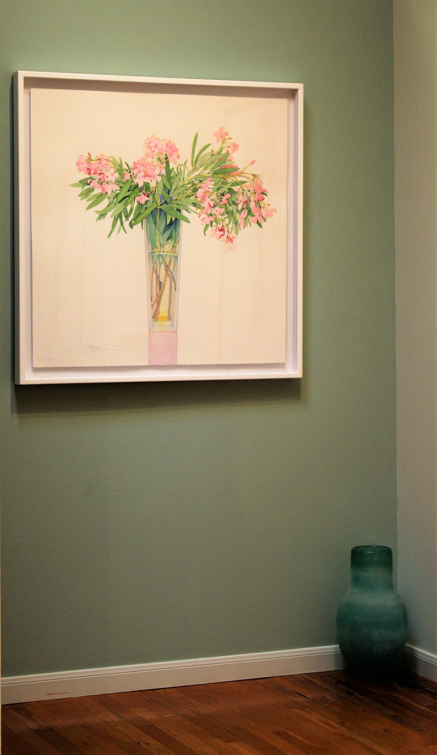"""A corner of Jody Klotz Fine Art, with a watercolor titled """"Oleander in a Tall Vase"""" by Gary Bukovnik."""