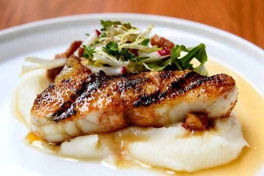 The Greenhouse's barbecued sturgeon chop comes with potato puree and fried shallots.
