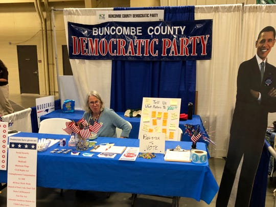 Volunteer Julie Montanea manned the Buncombe County Democratic Party booth at the Mountain State Fair on Sept. 9, 2019.