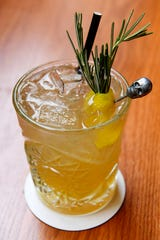 "The Greenhouse's ""midnight rambler"" cocktail is made with a Noble whiskey blend, Golden Arrow, honey and ginger syrup and lemon."