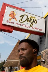 Michael Fisher stands outside his new hot dog shop Uncle Dogs on Tuesday, Sept. 10, 2019 in Battle Creek, Mich.