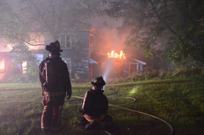 Firefighters battle the blaze at 91 W. Fountain St. early Tuesday.