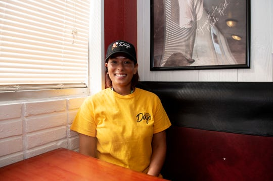 Rozetta Fisher poses for a portrait inside her new hot dog shop Uncle Dogs on Tuesday, Sept. 10, 2019 in Battle Creek, Mich.
