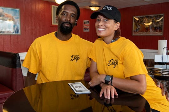 Husband and wife Michael and Rozetta Fisher pose for a portrait together at their new hot dog shop Uncle Dogs on Tuesday, Sept. 10, 2019 in Battle Creek, Mich.
