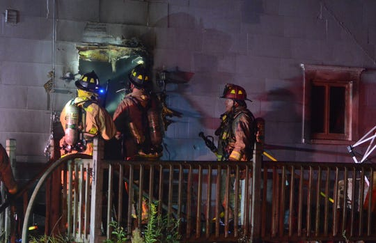 Firefighters search for more fire at the first fire of the early morning Tuesday on Wabash Avenue.