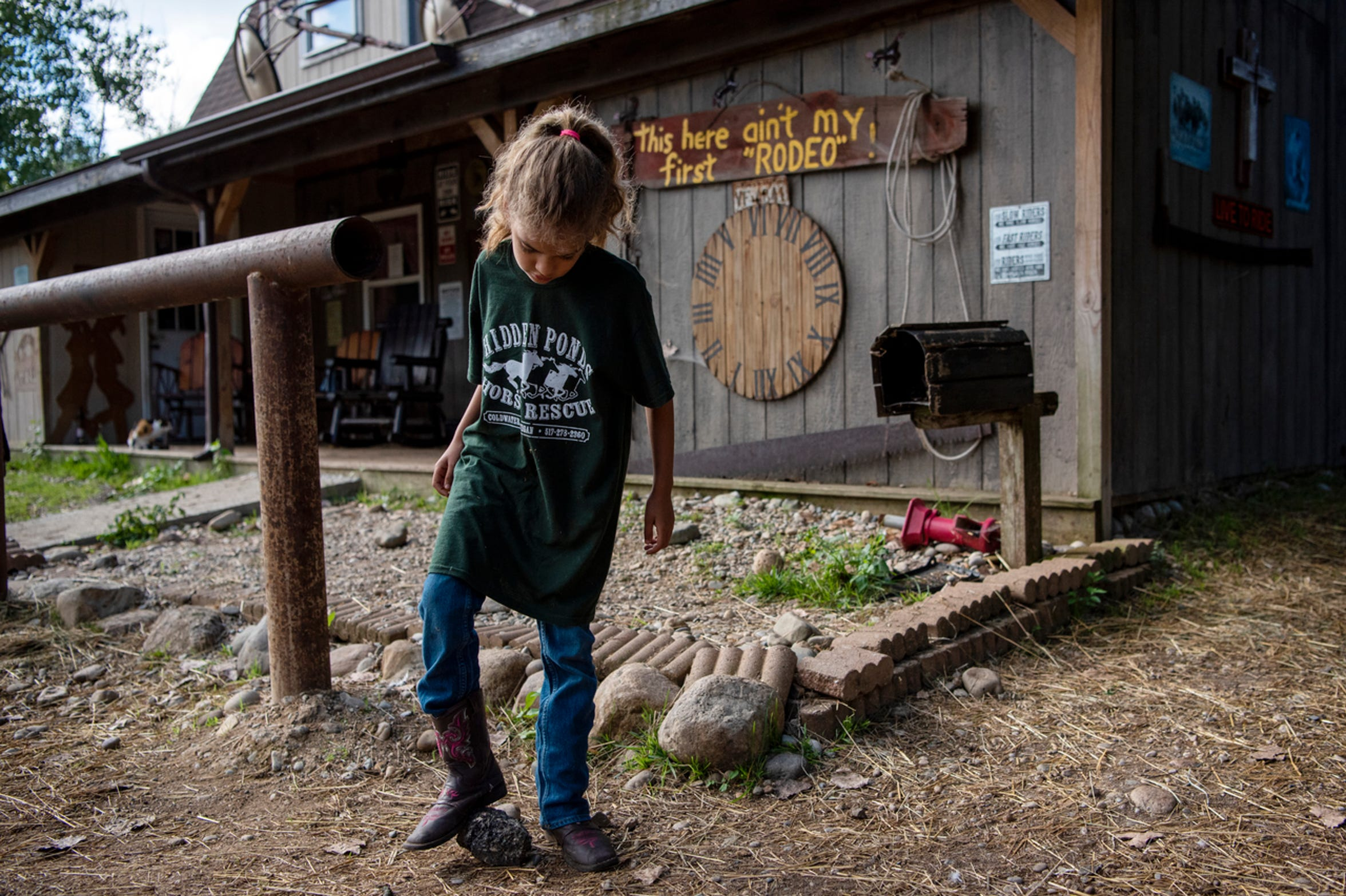 Victoria Gutierrez, 8, hangs out at Hidden Ponds Horse Rescue on Saturday, Sept. 7, 2019 in Coldwater, Mich. At Hidden Ponds, rescued horses are used for therapy, giving horses and humans a second chance.