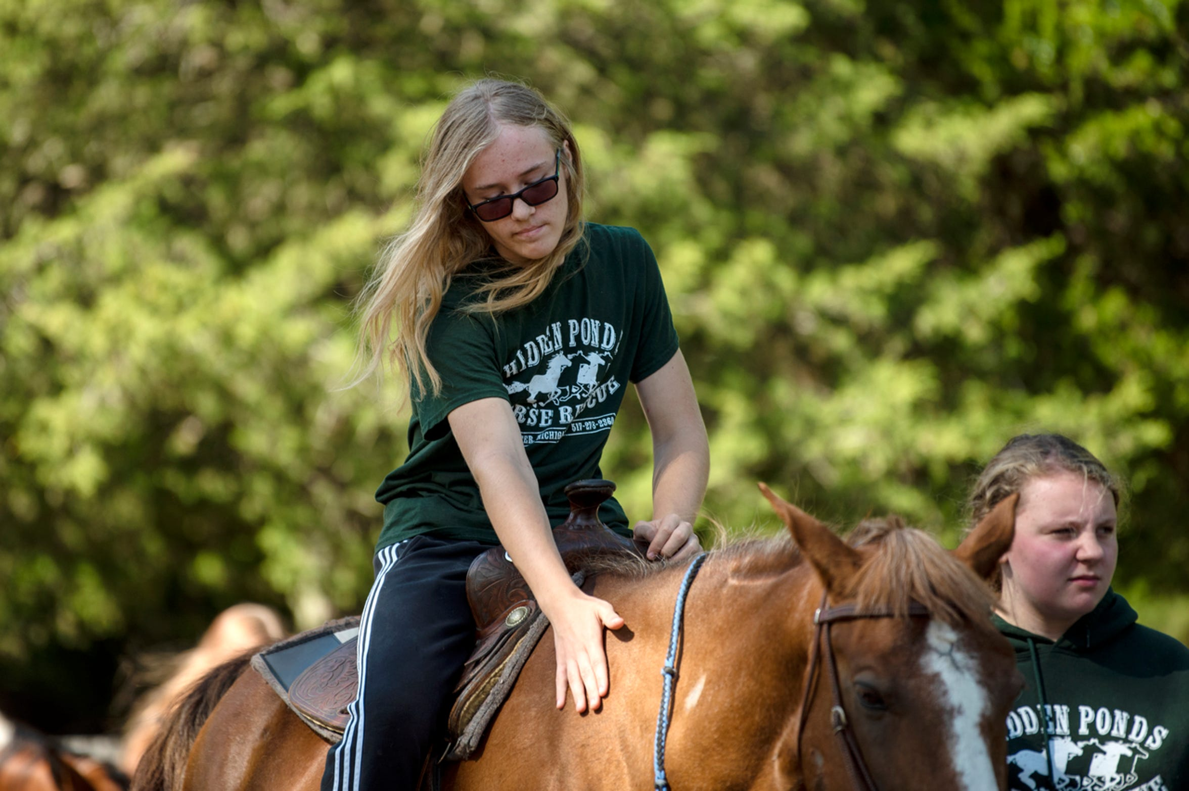 Gavin Shook, 13, rides Cher on Saturday, Sept. 7, 2019 at Hidden Ponds Horse Rescue in Coldwater, Mich. At Hidden Ponds, rescued horses are used for therapy, giving horses and humans a second chance.