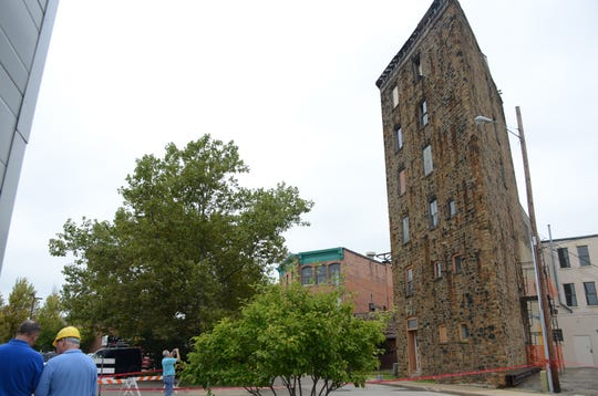 City officials and owner Bryant Debolt continue to study the condition of a 6-story building behind East Michigan Avenue.