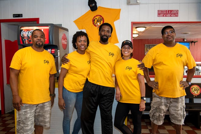 Family members Stephen Carpenter, Brianna Fisher, Michael Fisher, Rozetta Fisher and Everette Weathers at the new hot dog shop Uncle Dogs on Tuesday, Sept. 10, 2019 in Battle Creek, Mich.