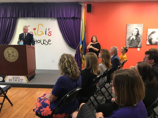 At GiGi's Playhouse in Vestal, an assembled crowd listens to Broome County Executive Jason Garnar deliver his budget address.