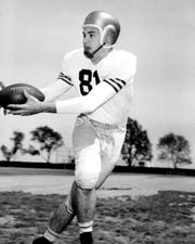 W. Earle Smith was team captain of the Naval Academy football team in 1956.