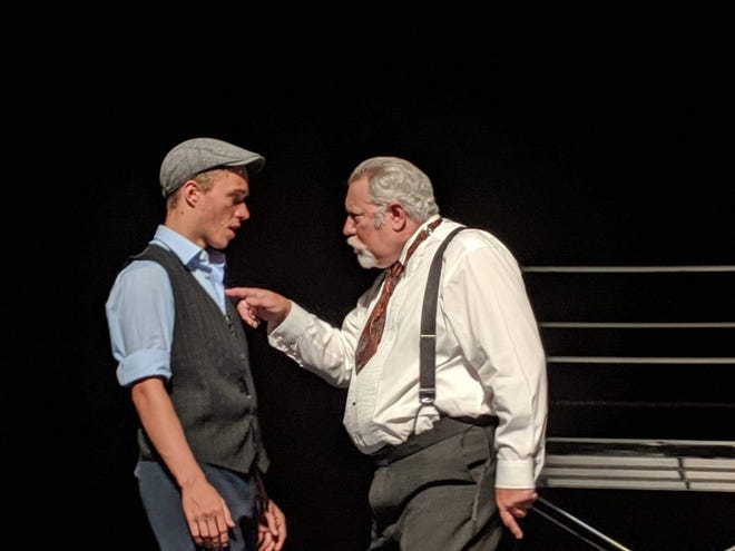 Joseph Pulitzer (Paul Adkins, right) has a thing or two to tell Jack Kelly (Glen Fritz).