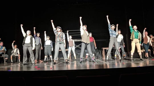 """The cast of CSTOCK's """"Newsies"""" rehearse a production number on the stage of the William D. Harvey Theater at Olympic College."""
