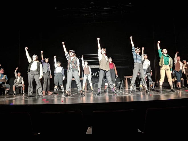 "The cast of CSTOCK's ""Newsies"" rehearse a production number on the stage of the William D. Harvey Theater at Olympic College."