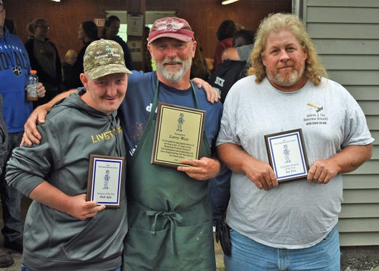 From left are Zack Again, 2019 volunteer of the year award winner; Larry West, outgoing festival director; and Joe Fox, 2019 committee member of the year award winner.