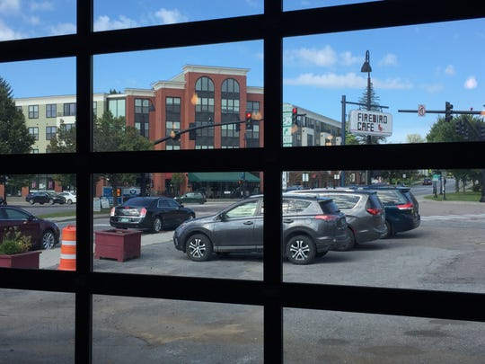 The two garage doors at the new Firebird Cafe location in Essex Junction look out on the busy Five Corners intersection.
