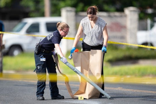 A large metal pipe is collected as evidence as the Corpus Christi police investigate an officer involved shooting in the 4500 block of Weber Road on Tuesday, Sept. 10, 2109.
