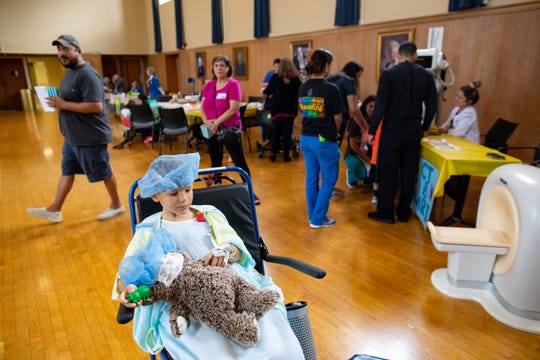 Eight-year-old Reagan Worley holds his teddy bear as he treats it during the Driscoll Children's Hospital's Teddy Bear Hospital event on Tuesday, Sept. 10, 2019