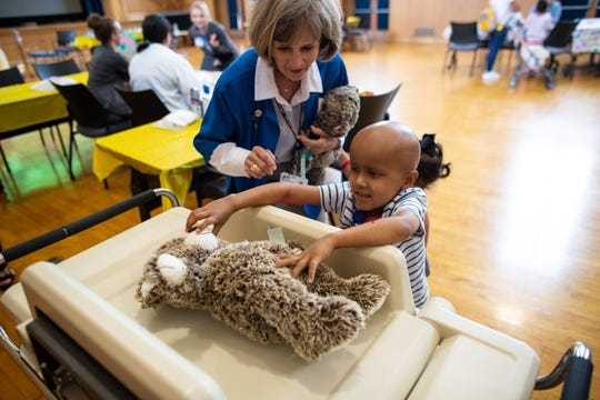 Four-year-old Grayson Sherman takes his teddy bear's wight during the Driscoll Children's Hospital's Teddy Bear Hospital event on Tuesday, Sept. 10, 2019
