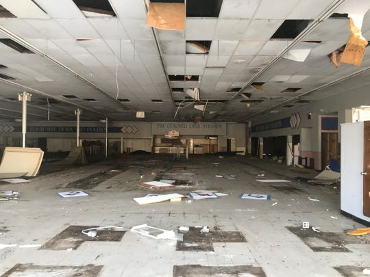 A former grocery store is deserted and dilapidated at Laurel Mills Shopping Center in Stratford.