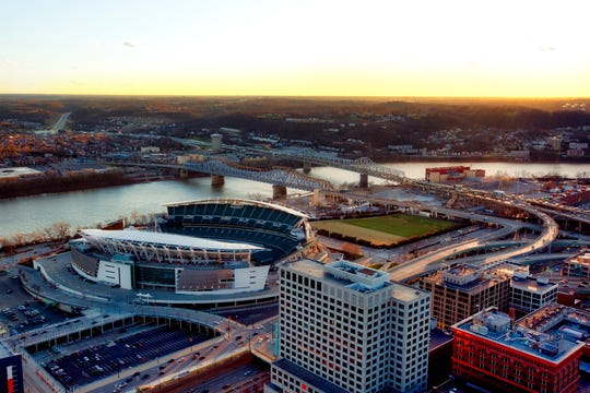 Aerial view of Cincinnati along the Ohio River, looking over into Covington Kentucky at sunset.